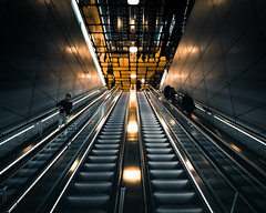 Noord-Zuidlijn Central Station (jst_pictures) Tags: amsterdam canon 6d canon6d camera photography street metro escalator gold dark new clean city citylife eos style yellow orange red black light lights bright white lines underground people flickr symmetry noordzuidlijn sharp colour colourful wallpaper reflection