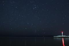 Hunter Risin' (~Jim Peacock~) Tags: night nightsky orion hyades autumn lakesuperior stars madelineisland bayfield wisconsin
