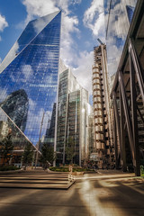 A City of Light and Shadows (Rich Walker75) Tags: london city cityscape buildings building architecture glass steel reflection reflections sky cloud futuristic metal plaza man human landscape landscapes landscapephotography canon england eos eos80d