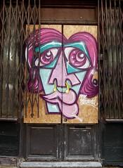 Centre Partings (Grooover) Tags: street art face doorway shutters paris france grooover