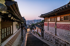 Sunrise scene of Bukchon Hanok Village at Seoul city, South Korea. Bukchon Hanok Village is home to hundreds of traditional houses. (MongkolChuewong) Tags: alley architectural architecture asia asian attraction background backpacker bukchon city cityscape culture day district downtown flag girl hanok historic historical home house korea korean landmark nseoultower neighborhood old people private residential road seoul seoulcity sky skyline south street style sunrise sunset tourism tourist tower traditional travel traveler village woman zone