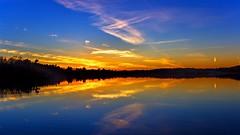Dusk's Reflection (Bob's Digital Eye) Tags: bobsdigitaleye canon clouds efs24mmf28stm laquintaessenza lakesunsets lakescape october2018 orange reflections silhouette skies sun sundown sunset sunsetsoverwater t3i trees twilight water flickr flicker