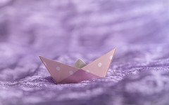 sailing on silk (Emma Varley) Tags: crinkledwrinkledfoldedorcreased macromondays origami paper boat pink spots folded silk scarf purple wrinkled texture craft sea waves