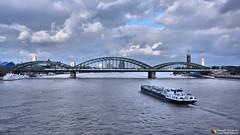 Rhein (Szymon Simon Karkowski) Tags: outdoor rhein river bridge train ice db landscape building buildings clouds sky water barge veendam rotterdam ferry wharf tower city town ship boat cologne germany nikon d7100