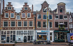 2018 - Amsterdam - Streetscape (Ted's photos - For Me & You) Tags: 2018 amsterdam cropped nikon nikond750 nikonfx tedmcgrath tedsphotos vignetting buildings windows doors umbrella streetscene street rabobank gewaeghtcafe cafe restaurant