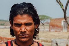 Squinting Village Man, Uttar Pradesh India (AdamCohn) Tags: adam cohn uttar pradesh india mathura vrindavan hair holi man portrait squint wwwadamcohncom adamcohn uttarpradesh jikhangaon