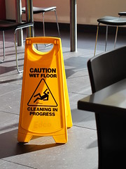 Caution wet floor (spelio) Tags: travel from outback july 2011 driving rural nsw australia warning sign