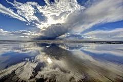 First we kiss (pauldunn52) Tags: beach reflection traeth mawr glamorgan heritage coast wales clouds wet sand sun