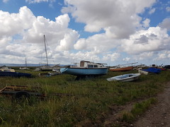 Heswall, United Kingdom (Shaun Smith-Milne) Tags: heswall wirral merseyside england britain greatbritain unitedkingdom europa europe angleterre grandebretagne royaumeuni heswallbeach beach strand marshland marais marsh boatyard groundedboats boat boats grounded échoué bateau bateaux abandonné abandoned ghostly empty vide desolate personne pathway path voie piste estuary river dee riverdee deeestuary estuaire northwales wales paysdegalles ghosttown dumping marine maritime sailboat hull grass herbe sailing voilier marécage trailer wreck wrecks naufrage naufrages lonely solitude loneliness haunting beauté beauty littoral coast coastline côte coastal shore shoreline