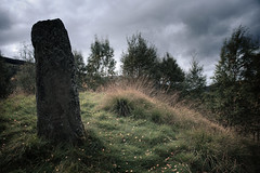 Standing Stone, Spittal of Glenshee (ShinyPhotoScotland) Tags: art places scotland perthshire toned building colour glenshee spittalofglenshee megalith standingstone pictish menhir hdr fujixh1 leaves grass old ancient trees wind clouds enfuse filmemulation syntheticfujiproviaemulation