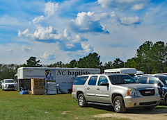 Field Parking Lot. (dccradio) Tags: lumberton nc northcarolina robesoncounty outdoor outdoors outside sky bluesky cloud clouds cloudformation september sunday afternoon fall autumn hydepark hydeparkbaptistchurch hurricaneflorence reliefstation disasterrelief naturaldisaster hurricane florence trailer ncbaptists baptistmen baptistsonmission grass lawn yard ground parkinglot field gmc yukon box boxes supplies canon powershot elph 520hs