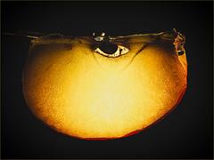 Apple of my Eye (Silke Klimesch) Tags: macromonday aeiou lowkey apple eye applewedge black golden youaretheappleofmyeye backlit apfel pomme măr mela manana maçã μήλο elma яблоко 苹果 olympus omd em5markii mzuikodigitaled60mm128macro luminar microfourthirds youarethesunshineofmylife steviewonder vowel vokal