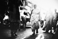 """Indian street..."" (Ilargia64) Tags: india street people light cow blackandwhite streetphotography monochrome shadows grain woman surprise amayasánchez chennai"