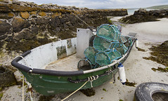 Boat on the sand on Isle of Barra (BUTEOGRAPHYGIRL) Tags: boat sand isleofbarra ropes beach fishingcreels green wall pier stone fenders