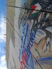 Israeli-built West Bank Wall surrounding Bethlehem with mural art, Bethlehem, West Bank, Israel (anthonyasael) Tags: anthonyasael asael westbank bethlechem betlehem bethlehem palestine israel middleeast asia mural art muralart colorful painting graffiti fresco drawing street streetart banksy artist politicsandgovernment buildstructure exterior buildingexterior wall separationwall concrete separation flag palestinianflag vertical nopeople israelpalestine