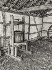 Pressing Grapes (enneafive) Tags: winepress grapes vintage openairmuseum bokrijk agriculture monochrome affinityphoto loantimber wood loam straw barn