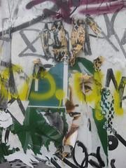 Gazing out (Niecieden) Tags: 2010 july london spitalfields canondigitalixus90is graffiti pasteup face girl
