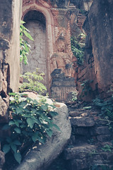 Myanmar | Nyaung Ohak (Nicholas Olesen Photography) Tags: myanmar asia vertical nyaung ohak inle lake inthein indein travel nikon temple religion history historic building architecture old vegetation buddha statue outdoors d90