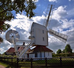 The beautifully restored Wind Pump at Thorpeness, Suffolk. 07 08 2016 (pnb511) Tags: thorpeness suffolk windpump windmill trees grass sails mill east anglia sky clouds seaside rural unspoilt