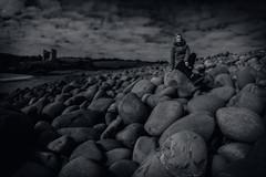 Karen relaxing on the Rocks (To see a World in a Grain of Sand And a Heaven in ) Tags: minard nikond810 samyang12mmf28 fisheyelens countykerry ireland ancientireland wildatlanticway beach rock castle water sea kilmurrybeach dingle