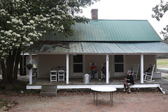 Slaughter sits with Brian Hardy, (left) Kip Hardy, Marin Hardy, and Jennifer Teems Seay (right) on her porch. The building was used as a kitchen when it was first built.