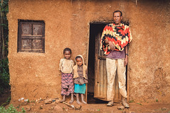 Chocolate (u c c r o w) Tags: father children portrait awasa ethiopia ethiopian colors colorful uccrow urban urbanlife cottage