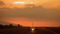 MROC / SJO. (Bernal Saborio G. (berkuspic)) Tags: sunset sun clouds afternoon airplane airport commercialflight