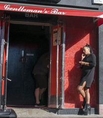 DSC_9440b Shoreditch High Street London Rainbow Sports Bar Exotic Dancer Venue Gentleman's Bar Lady on the Phone Smoking (photographer695) Tags: shoreditch london high street rainbow sports bar exotic dancer venue gentlemans lady phone smoking