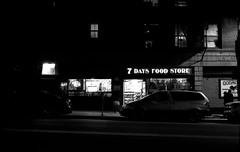 Lazar's 7 Gods (stevenguz) Tags: streetphotography night nightphotography japanesecamerahunter jchstreetpan400 ilfosol3 rapidfixer epsonv600 canonet canonetql17giii sanpedro bw blackandwhite town lights shadows highlights solitary walk 35mm film 35mmfilm analog