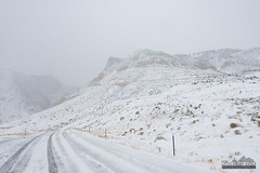 Slick and Steep (kevin-palmer) Tags: october fall autumn nikond750 lovell snow snowy cold cloudy overcast snowstorm highway14a road slick covered icy steep tamron2470mmf28 lowvisibility tracks bighornmountains white