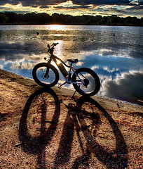 Rad power rover e-bike. (NYC sharpshooter) Tags: refections shadows bikes sports mountain biking rad power electric fat tires lakes nyc queens flushing meadow park sunsets bicycle bike battery transportation technology cycle transport energy electricity healthy green urban city ebike nature lifestyle motion sport summer activity white motor caucasian color day people outdoor ecologic travel background vehicle environment ride e ecology women design hybrid recreation future modern scooter