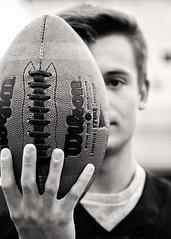 Football (Jenny Onsager) Tags: football americanfootball athletics highschool laces gameball blackandwhite abstract artsy teenboy tough athlete