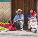 A Man and a Woman Selling Mandarins.