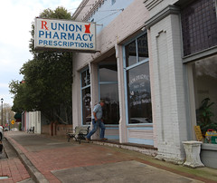 Tim Bryant, 54, a logger from Union Point, Georgia, approaches the entrance to the pharmacy.