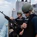 Sailors man an M240B machine gun as the USS Ashland (LSD 48) departs Subic Bay to conduct amphibious operations for KAMANDAG 2