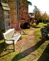 Churchyard St Mary's church (laurapage839) Tags: bench gravestone stmaryschurch goudhurst kent weald uk mobilephonephoto moto light shadows