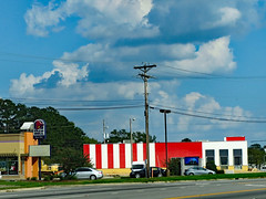 Taco Bell And KFC. (dccradio) Tags: lumberton nc northcarolina robesoncounty outdoor outdoors outside sky bluesky cloud clouds cloudformation september sunday afternoon fall autumn restaurant food eat eatout fastfood kfc kentuckyfriedchickentacobell pole powerpole electricpole utilitypole grass lawn traffic paved pavement robertsavenue powerlines utilitylines electriclines powerwires utilitywires electricwires wires lines sign words text canon powershot elph 520hs