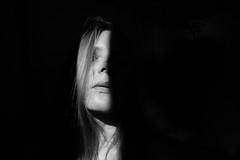 enter the void (Eli Modje) Tags: eye minimalism minimal grey persona melancholy noir black mystery light shadow hair girl face blackandwhite bw body portrait