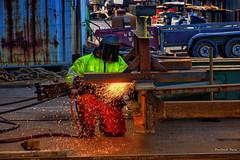 """It Ain't Half Hot Mum "" (Pensioner Percy) Tags: maryport working welder england boats cumbria people hot flames nikon d7200 nikond7200 nikonlens nikon18140lens acdsee boatyard dxo mpmnorthwest manualsetting highviz mask fire moltenmetal sparks steel rust metal"