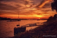Sunset, Voerde -Germany (Stathis Iordanidis) Tags: dramaticclouds orangesky germany voerde promenade riverside river rhine sun sundown sunset