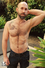 Geoff (Levi Smith Photography) Tags: tattoo tattoos shirtless plants garden pose statue pants jeans phoenix bald bear abs chest hairy man brown beard arms biceps armpit fashion men mans mens