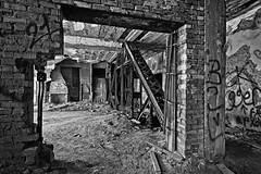 Broken wall (jkotrub) Tags: urbex urban explore decay architecture rust dust indoors inside damage graffiti texture photowalk beauty lines time rubble derelict wall brick door masonry wooden worn concrete