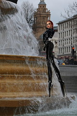 Climbing the Fountain is Tricky in these Heels (SoakinJo) Tags: trafalgarsquare wetlook wetclothes wetleather highheels stilettos balletheels london