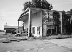 But the RV Park is Lovely (lancekingphoto) Tags: abandoned neglected building wittsusedcars paintedsign rvpark etowah tennessee thesouth bwfp chinonbellami silberrapan100 35mm film xtol