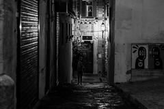Alfama is calling (Özgür Gürgey) Tags: 2018 50mm alfama bw d750 darkcity lisboa lisbon nikon portugal alley evening graffiti lamp lowlight people street