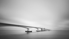 'zeelandbrug on a grey day' (Jeannette Maandag) Tags: zeeland netherlands longexposure bigstopper greyfilter blackandwhite bw fujixt20 samyang 12mm