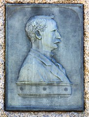"""Bronze plaque on the tombstone of Dr. Herman Olaus Fjelde (April 13, 1866 - July 14, 1918) in the Lakewood Cemetery in Minneapolis, Minnesota - Inscription on the bottom of the bronze plaque states:  """"Portrait - Modeled in New York MCMXVI - Paul R. Fjelde (thstrand) Tags: historicperson medicaldoctor medicine sculptor 1900s 1916 19thcentury adultmale americans art arts artwork bronzeplaque customsandtraditions dead death doctor doctors dr funeraryritesandrituals gravesite gravesites graveyard hermanfjelde hermanolausfjelde lakewoodcemetery md mn man minneapolis minnesota norwegianamerican norwegianancestry old paulfjelde plaques portrait portraits profile reliefsculpture sculpture us usa unitedstates vintage visualarts"""