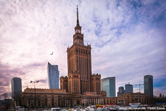 Warsaw, Poland. Palace of Culture and Science and downtown busin (Nikos Stamos photography) Tags: poland architecture attraction beautiful bird blue brick building business capital castle center city cityscape classic clouds color colored colorful construction culture day destination district downtown editorial europe european exhibitionarea exterior famous financial flying heritage high historic historical history holiday houses huge international king landmark large modern monument orange outdoor palace polish polska public red road scene scenery science sightseeing sky skyscraper street symbol tall top tourism tourist tower town travel urban view warsaw warsawa window