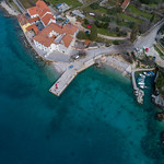 Ariel view of small harbor, pebble beach and monastery thumbnail
