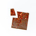 Top View of an organic protein chocolate with strawberry pieces on white background